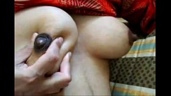 south indian aunty squashing milk udders-more.