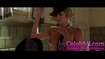 charlize theron in tub having romp head in.