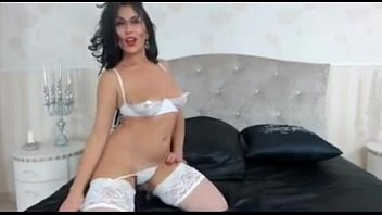 raven haired cougar taunts in tights.