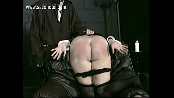 nasty nun with her underpants down is spanked.