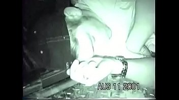 Drunk guy puking in back of pickup bed.