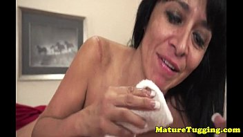 thick-chested mature gets facial cumshot after providing hand job