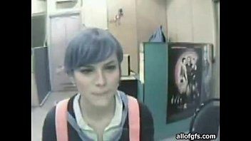 blue haired punk woman taunts on web cam.