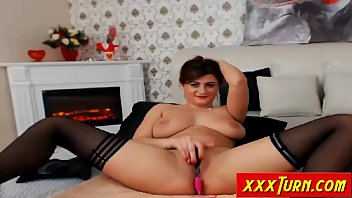 massive-boobed mature kneads her poon bald on cam.
